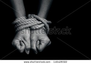 stock-photo-hands-of-a-missing-kidnapped-abused-hostage-victim-woman-tied-up-with-rope-in-emotional-stress-146428322