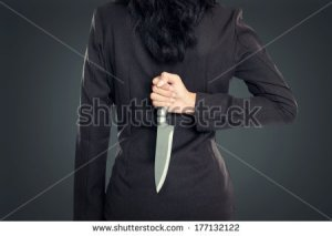 stock-photo-business-woman-holding-knife-behind-her-back-conceptual-image-177132122